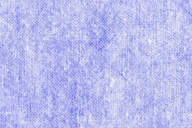 Das gewebe ist indigofarbstoff, lokales gewebe, indigobindefarbmuster auf baumwollgewebeauszugshintergrund.