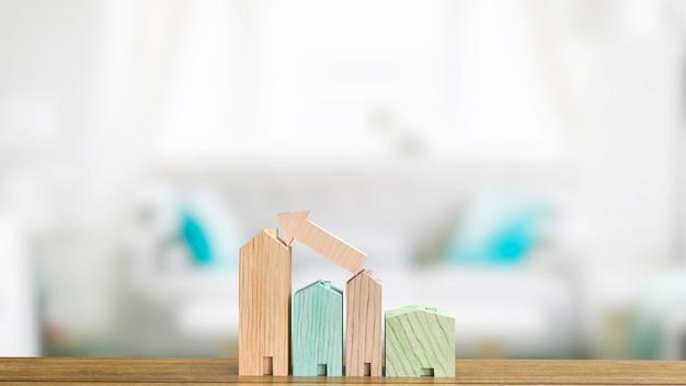 Das hausholz auf dem tisch für das 3d-rendering des immobiliengeschäftskonzepts