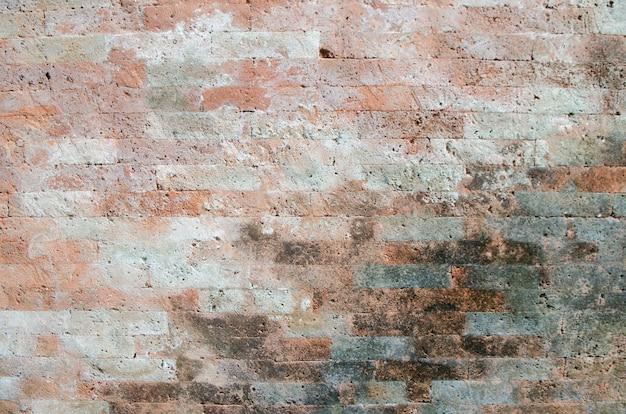 Das hintergrundbild der alten backsteinmauer
