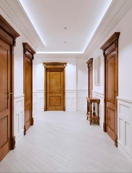Das innere ist ein korridor im klassischen stil mit weißen wänden und wandpaneelen sowie holzmöbeln und -türen. 3d-rendering.