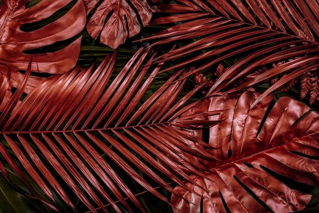 Das konzept der blätter mit roten blättern abstrakten tropischen blättern natürlichen hintergrund
