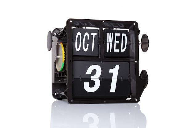 Das mechanische kalender-retro- datum am 31. oktober an lokalisiertem glücklichem halloween.