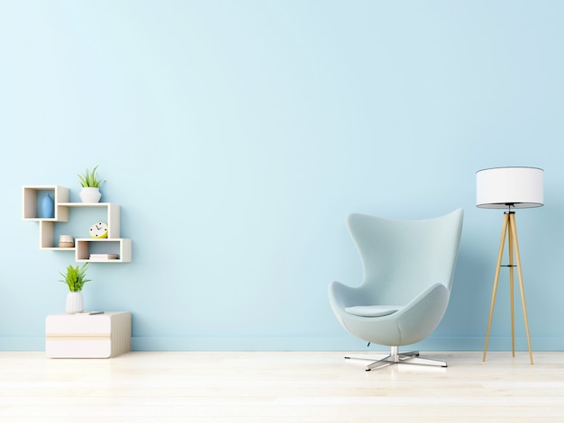 Das moderne wohnzimmer mit blauem sessel verfügt über einen schrank und holzregale auf holzböden