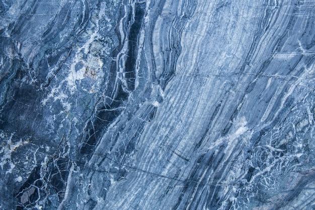 Das muster und die oberfläche der blauen, marmorwände für das hintergrund- und fliesendesign.