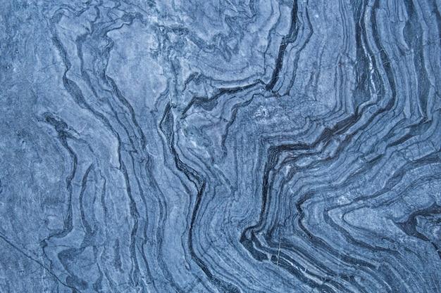 Das muster und die oberfläche der blauen, weißen und schwarzen marmorwände für den hintergrund.