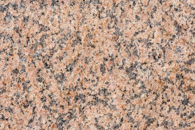 Das natürliche muster und die textur der roten granitoberfläche mehrfarbiger steinhintergrund