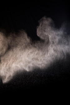 Das spritzen von staub pulver