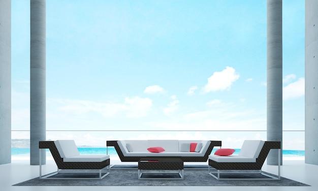 Das wohnzimmer im freien und die dekoration von sofamöbeln und der hintergrund mit meerblick