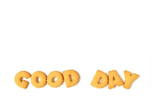 Das wort good day wurde mit alphabetförmigen keksen geschrieben
