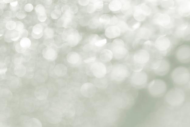 Defocused abstrakte lichter des silbernen lichtes der reflexion.
