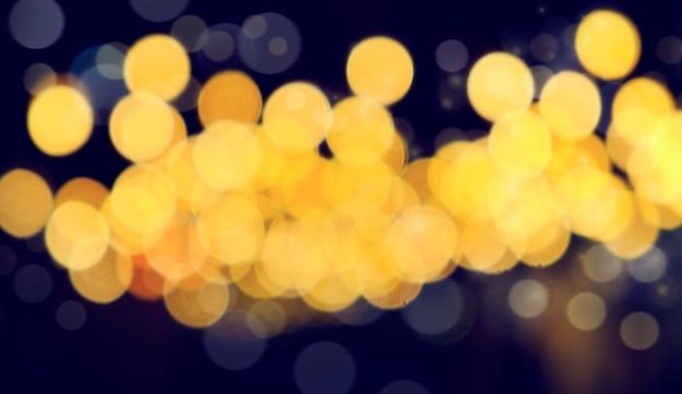 Defocused bokeh licht, abstrakter hintergrund am nachtfoto