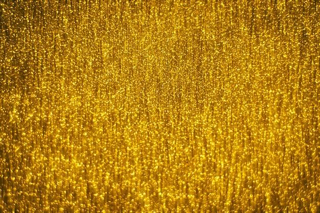 Defocused hintergrund des abstrakten goldglisters