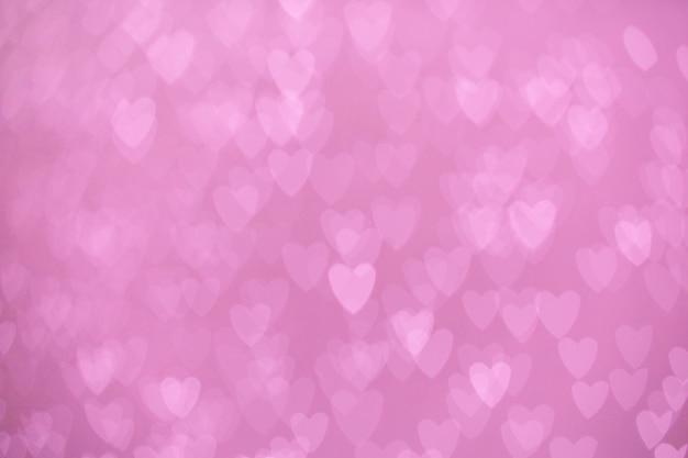 Defocused lichter bokeh hintergrund von rosa herzen