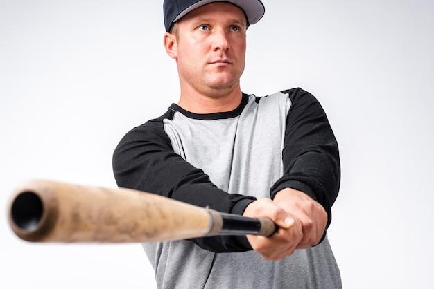 Defocused nahaufnahme des baseballschlägers mit spieler