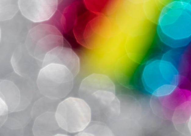 Defokussierter lebendiger regenbogenglitter