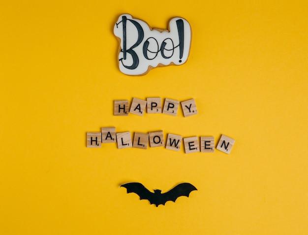 Dekorationen für halloween-feier auf gelb