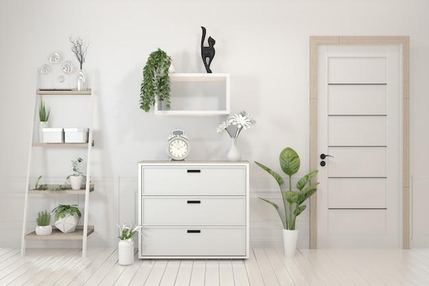 Dekorationspflanzen auf kabinett im weißen wohnzimmerinnenraum.