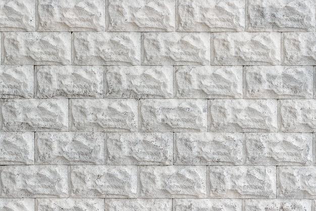 Dekorative backsteinmauer gemalt in der weißen nahaufnahme als hintergrund oder beschaffenheit.