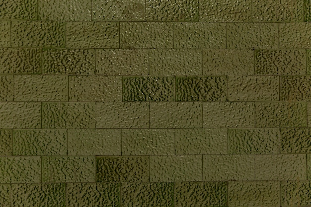 Dekorative grüne fliesen an der wand. hintergrund. platz für text.