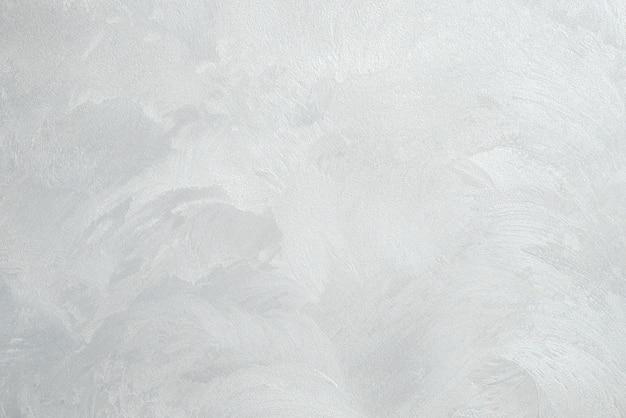 Dekorativer putz. grauer wandbeschaffenheitshintergrund. konkreter stil. restaurierung im innenbereich. wartungsarbeiten.
