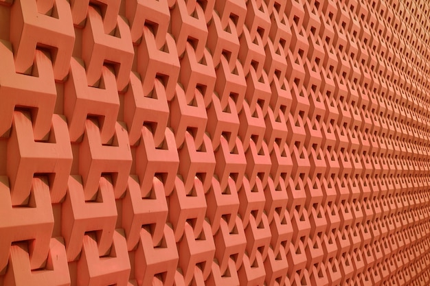 Dekoratives muster der gebäudewand in der tiefen orange