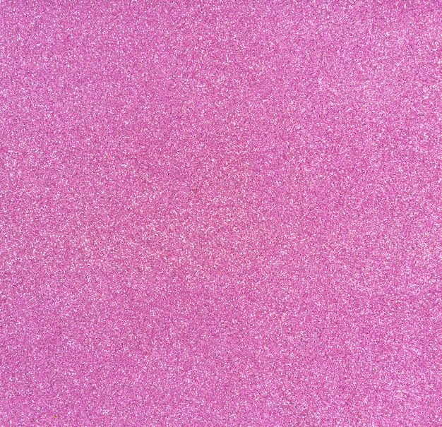 Dekorpapier mit glitzer, kreativitätsware. rosa glänzender hintergrund.