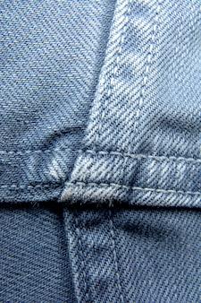 Denimblue jeans masern mit kratzern / abstraktem hintergrundmuster