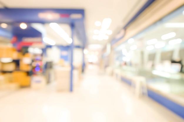 Der abstrakte defokussierte unscharfe hintergrund des einkaufszentrums. unternehmenskonzept.