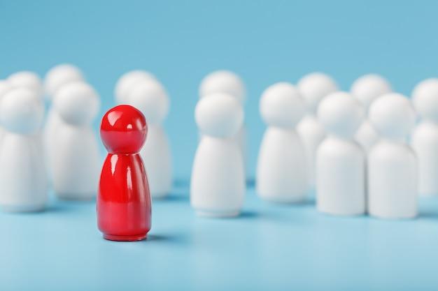 Der anführer in rot führt eine gruppe weißer mitarbeiter zum sieg, zur personalabteilung und zur personalrekrutierung. das konzept der führung.