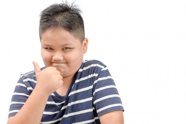 Der asiatische junge, der daumen zeigt, up geste