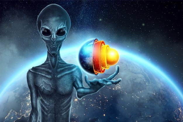 Der graue alien humanoid hält ein hologramm des globus auf der hand. ufo-konzept, außerirdische, kontakt mit der außerirdischen zivilisation.