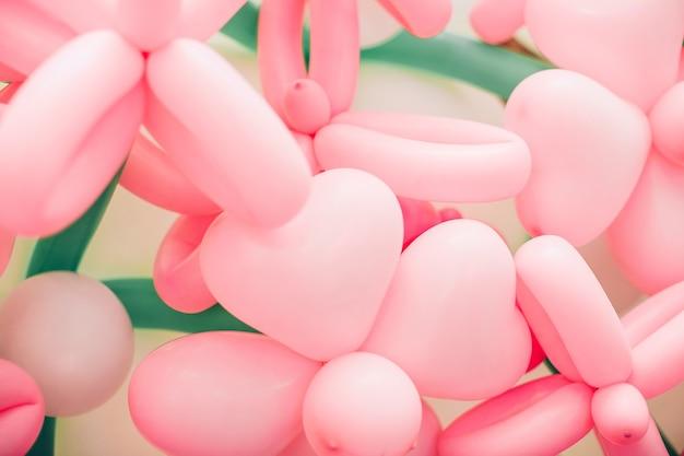 Der hintergrund der rosa blumen von luftballons.
