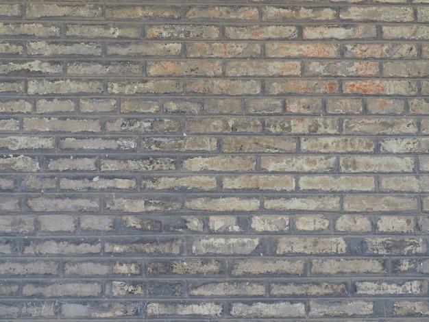 Der hintergrund einer wand aus grauen backsteinblöcken