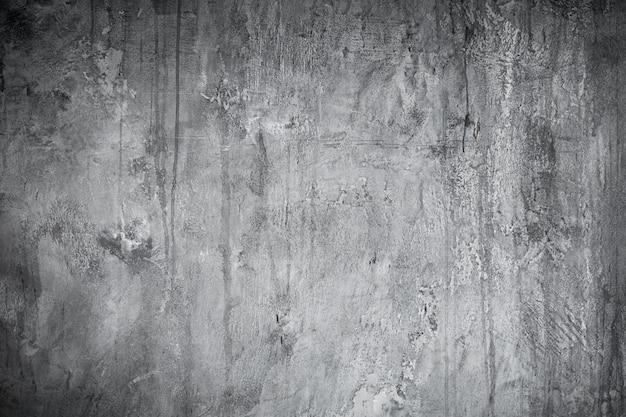 Der hintergrund ist eine konkrete schmutzige textur mit silbernen, grauen und weißen farben. alte loftwand