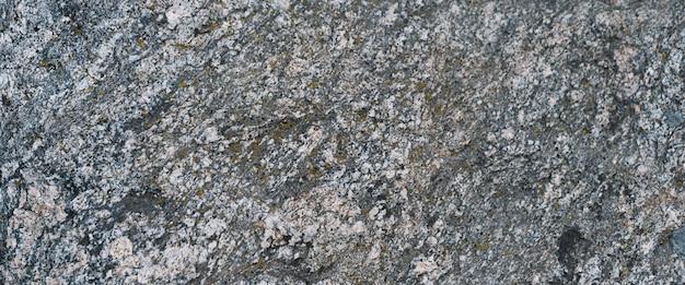 Der hintergrund ist fester grauer granit als bildschirmschoner oder hintergrundbild.