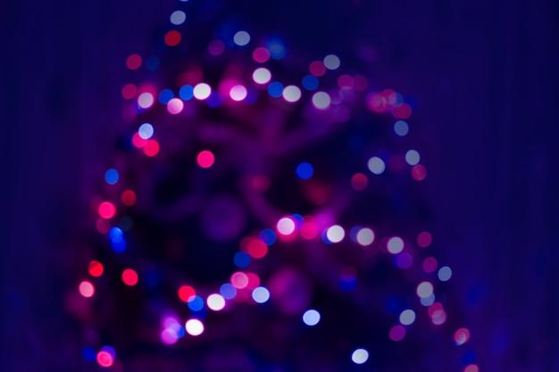 Der hintergrund jedoch unscharf nacht bokeh konzert. bühnenbeleuchtung auf konzert. unscharf gestelltes konzertlicht. abstraktes festival des unschärfehintergrundes