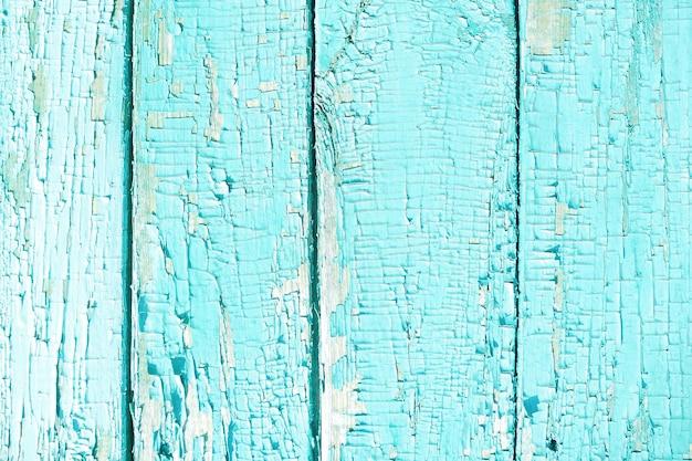 Der hintergrund und die beschaffenheit der gemalten blauen bretter mit alter und gebrochener farbe.