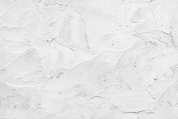 Der hintergrund und die oberfläche der weißen betonwand.
