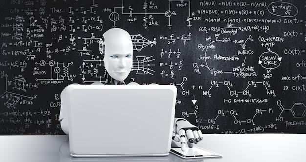 Der humanoide roboter benutzt einen laptop und sitzt am tisch, um ingenieurwissenschaften zu studieren