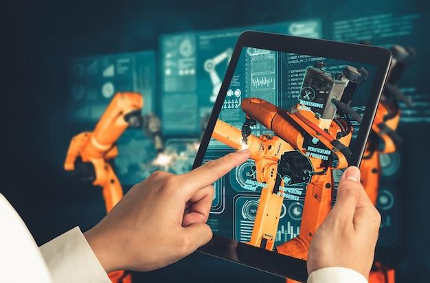 Der ingenieur steuert roboterarme mithilfe der augmented-reality-industrietechnologie