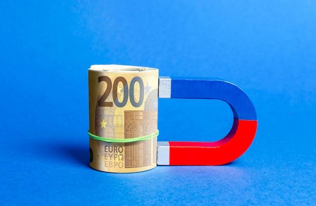 Der magnet ist zum eurobündel magnetisiert. geld und investitionen für geschäftliche zwecke anziehen