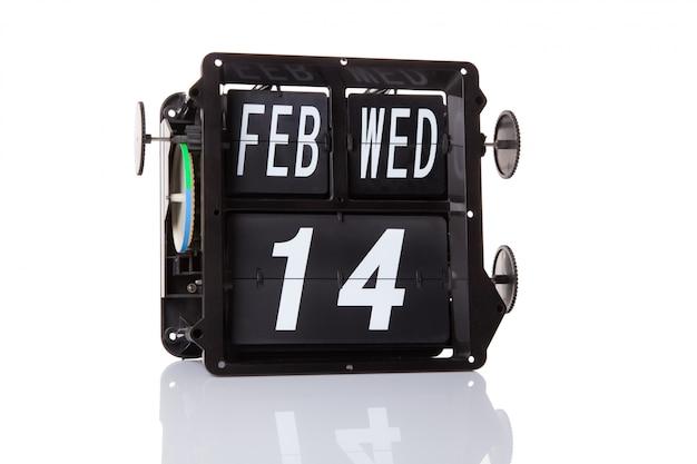 Der mechanische kalender retro-datum 14. februar, isoliert valentinstag.