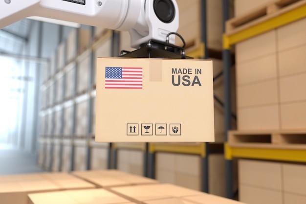 Der roboterarm nimmt den karton made in usa automation-roboterarm im lagerhaus auf