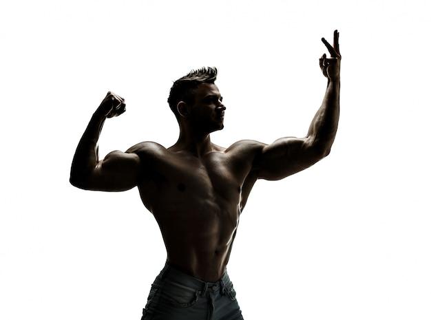 Der schöne und starke junge mann, silhouette