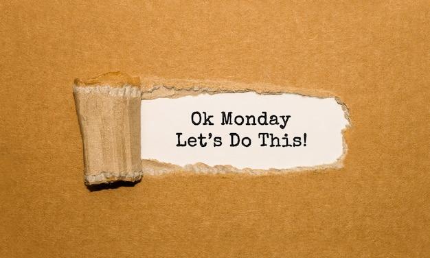 Der text ok monday lets do this erscheint hinter zerrissenem braunem papier