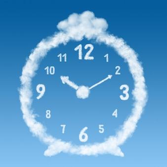 Der wecker aus wolken auf einer blauen himmelsoberfläche