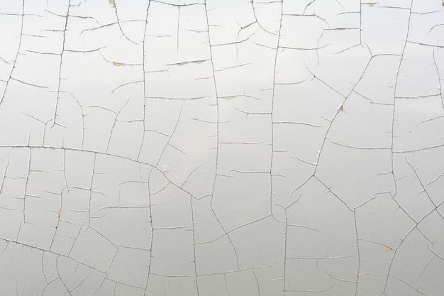 Detail der gebrochenen farbe auf dachauto