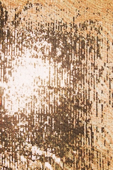 Detail der glänzenden goldenen paillette im hintergrund