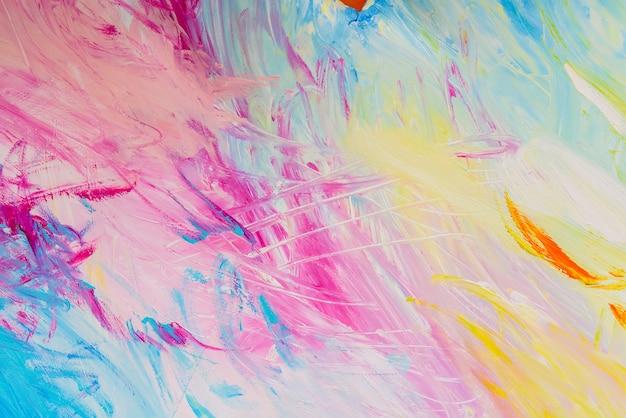 Detail von bürstenanschlägen von gelegentlichen farben, die in der schule als hintergrund und beschaffenheit im handwerk verwendet werden.