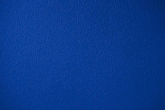 Detaillierte nahaufnahme der blauen oder klassischen trendigen farbputzwandbeschaffenheit